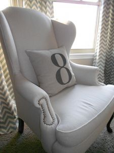 Linen upholstered chair against chevron curtains complete with a numbered pillow. Is there anything better? Number 8, Lucky Number, Upholstered Chairs, Wingback Chair, Chevron Curtains, Coral Chevron, Take A Seat, How To Introduce Yourself, Infinity