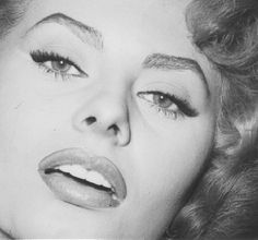 Vintage makeup-- cat eyes, perfect brows, luscious lips.