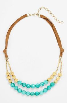 Love the teal beads on this boho style necklace.