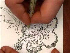 Zentangle Flower and there's also a video of a zentangle rose that's pretty cool too!
