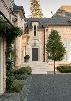 The stately entrance to an Anglo-French inspired home by Pursley Dixon Architecture. Landscape architecture by Craig Bergmann. French Architecture, Landscape Architecture, Architecture Design, Architecture Courtyard, Modern Residential Architecture, Landscape Steps, Beautiful Architecture, French Style Homes, French Country Style