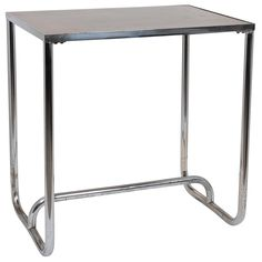 Chrome Leg Table with Bakelite Insert Top   From a unique collection of antique and modern side tables at http://www.1stdibs.com/furniture/tables/side-tables/