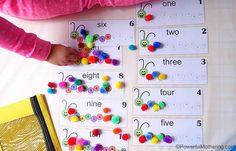 This is a image of a learning activity for two years old children. It's a fun to learn numbers and counting. They need printtable, pom poms and counting caterpiller busy bugs.