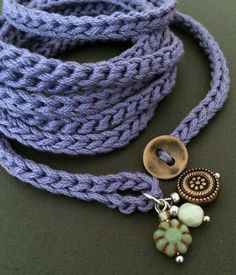 Light and soft crochet wrap bracelet or necklace made of cotton yarn in lavender featuring glass and metal bead charms. This fun and versatile accessory is approximately 54 (137.16 cm) long and wraps about 7 times around a 6 - 7 wrist but can be wrapped more or less times to fit any size. This versatile wrap also makes a great simple, soft necklace that can be worn wrapped, knotted, layered and many other ways around your neck - let your imagination guide you! Closes with a loop and brass…
