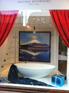 OB Tranquil Christmas window with xinia bath by Ashton & Bentley and bespoke Christmas tree towel rail from Bard & Brazier