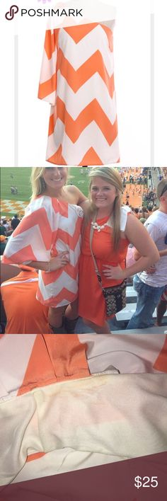 One Shoulder Chevron Dress Bought at a boutique in Atlanta and LOVED it! Wore it 3 times max. It has a few very small unnoticeable makeup stains on the inside of the neck as shown in the picture i posted but other than that it's in excellent condition! The brand is Pink Owl & it's a women's size small! Colors are orange & white (go Vols!) Make offers! Dresses One Shoulder