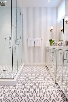 white bathroom with hexagonal floor tile