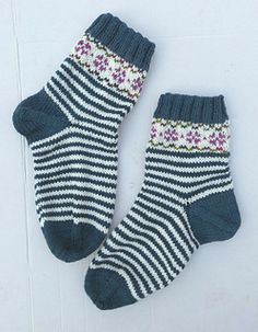 These are quick little socks because they have short legs. They look stylish but just rely on striping and a lot of plain knitting. An after thought heel mimics the ordinary toe construction. The stranding is basic- only a few rows and only two colors at a time. This is an easy way to to learn about stranded color work.You can also use up some of those odd little leftover balls of sock yarn.