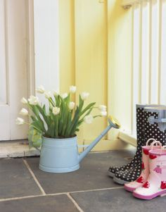 Use an old watering can as a planter for your favorite flowers. To add an additional pop of color, paint the can in a coordinating color.