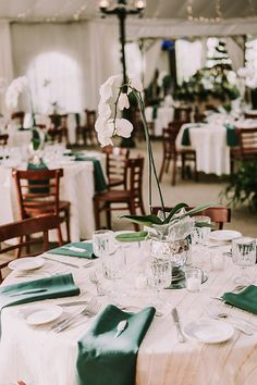 EMERALD AND orchid centerpieces - photo by Shelly Anderson Photography http://ruffledblog.com/peter-pan-inspired-wedding