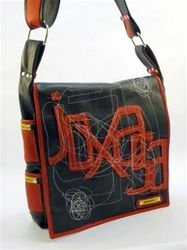 Black messenger bag is hand constructed of black and red leather. Flap features hand rendering of the joxasa logo with infinity stitching... a joxasa signature. Interior lined in gray sport material that is highly durable and cleanable. Interior is lined completely in red Italian leather. Messenger bag features a 2 inch wide strap, silver hardware and 4 interior/smartphone pockets. Personally handmade in the USA by Designer John Xavier Sanders of Joxasa