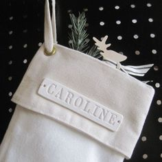 Personalize the stocking... this one is ceramic. Could stamp clay?