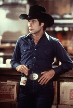 John Travolta (not a Texan) in Urban Cowboy.  But the Lone Star longneck and black felt hat were nice props.
