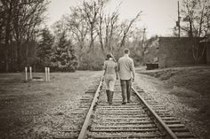 romantic photo engagement pictures train tracks conway engagement photos at the river walk #riverwalk #conway #engagementphotographer #myrtlebeach