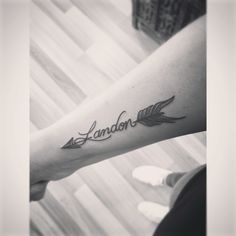 Arrow tattoo with my sons name! The tale end is more like a… Arrow tattoo with my sons name! The tale end is more like a feather I love the mixture my artist customized for me. Time Tattoos, Body Art Tattoos, New Tattoos, Print Tattoos, Sleeve Tattoos, Cool Tattoos, Tatoos, Mouse Tattoos, Ankle Tattoos