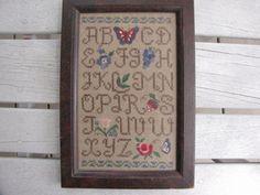 Framed Antique cross stitch sampler