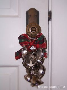 Please share!Sawthis Jingle Bell Swagon the PB website for $59 (red ribbon not included!).  I didn't even need Cheapy Cheaperson to tell me I could make one of those! I had just seen silver bells in the Christmas section of Dollar Tree the day before! To make a Jingle Bell Swag, you will need: …
