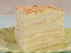 Throwdown's Toasted Coconut Cake with Coconut Filling and Coconut Buttercream Recipe : Bobby Flay : Recipes : Food Network Coconut Buttercream, Buttercream Recipe, Just Desserts, Delicious Desserts, Yummy Food, Cake Recipes, Dessert Recipes, Yummy Recipes, Baking Recipes