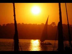 A faluka, Egypt's traditional sailboat, sails at sunset in the Nile River in Luxor in Upper Egypt. Luxor, Egyptian Mythology, Nile River, Mystery Of History, Anubis, Sailboat, Dream Vacations, Sailing, Egypt