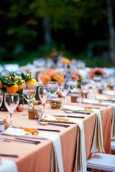 like the napkins with single flower on them.  no plates since we are having plated dinner... orange fall wedding tablescape