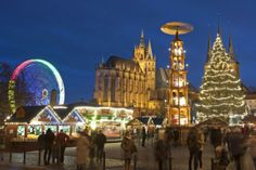 Germany: People walk along the Christmas Fair in front of the Mariendom (Cathedral of Mary) and St. Severi's Church in Erfurt, Germany. (AP Photo/Jens Meyer)