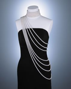 This princess-inspired masterpiece has seven long strands that drape across the body and eight choker-length numbers, all featuring 1,490 akoya pearls ranging in size from 6.5 mm to 9.5 mm. It took Mikimoto six months to collect all the pearls, and then another six months to make it.
