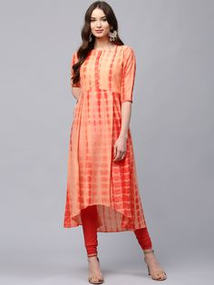 Buy Libas Women Orange Dyed A-Line Kurta online in India at best price.Orange dyed Anarkali kurta, has a round neck, three-quarter sleeves, high-low hem, no slits Next Dresses, Girls Dresses, Kurtha Designs, Kurta Cotton, A Line Kurti, Recycled Dress, Kurti Embroidery Design, Neck Designs For Suits, Kurta Designs Women