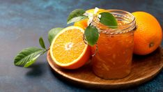 orange jam in a glass jar, fresh oranges on a wooden plate on a blue background Rhubarb Gin, Orange Jam, Squash Puree, Pumpkin Pudding, Long Drink, Dried Figs, Pink Drinks, Vegetable Drinks, Wine Recipes