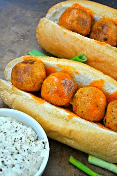 Vegan tempeh meatballs flavored with Buffalo sauce. These vegan meatball subs are the greatest. Meatballs on a toasted Hoagie topped with vegan blue cheese!