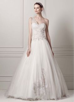 Brand new, never been worn. Enchanting and elegant, this one shoulder gown is the definition of romance. The sweetheart neckline is accented with an on-trend embellished one shoulder detail. Ornate be
