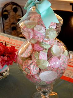 Love this centerpiece for a girl's cupcake party, cupcake liners in a glass jar or anything for that matter