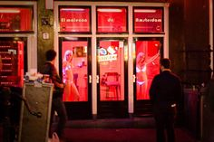 The red light district also called 'De Wallen'. Most of the people know for a fact that this is the place that you have to visit, when you are visiting the Netherlands and Amsterdam.  The red light district consists of a network of alleys containing approximately three hundred one-room cabins rented by prostitutes who offer their sexual services from behind a window or glass door, typically illuminated with red lights.