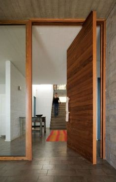 Staircase design and wood slat door | interior design idea