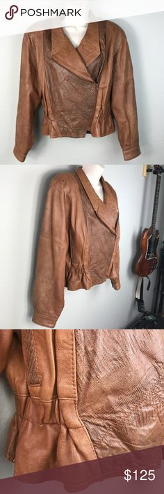 """VTG 80s tan """"snakeskin"""" jacket Made in Italy VTG late 80s Salman 100% leather tan jacket with a snakeskin like patchwork design on front and back, elastic waist for a slimmer fit and two pockets in front. Drop dead gorgeous Italian coat in great vintage condition. A few minor imperfections but really this looks almost new. Awesome graphic interior lining. Can be worn with jeans in Main Street America or with wide leg plaid pants for Paris Fashion Week. Vintage Jackets & Coats"""