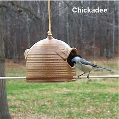 Pottery Bird Feeder in Warm Brown and Brown for feeding sunflower seeds to your favorite birds