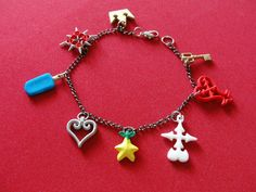 Hey, I found this really awesome Etsy listing at http://www.etsy.com/listing/104251103/kingdom-hearts-charm-bracelet