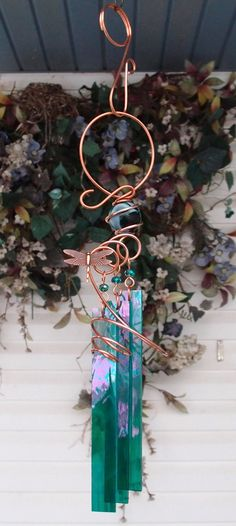This magical chime was created with a shimmering 1 inch diameter teal swirl glass orb nestled within solid hand sculpted copper (a semi-precious
