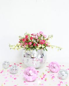 DIY Disco Ball Vase. How pretty do these pink flowers look inside of a sparkly disco ball?!