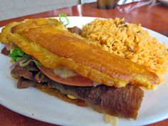 The Gyros Jibarito: a Puerto Rican sandwich consisting of gyro meat, lettuce, tomato, cheese and gooey mayo between two starchy flats of fried plaintain