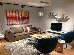 BoConcept Mezzo sofa, Schelly chairs, Occa 94 TV console, Rain Rhapsody art