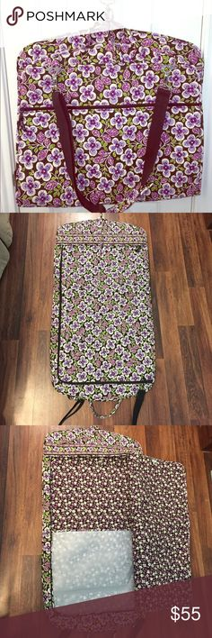 "Vera Bradley Garment Bag Vera Bradley garment bag, only used once, in excellent condition.  Bag measures approx. 22"" wide & 42"" long (not including strap/handle).  Has outer zippered pocket measuring 22"" x 16.5"", detachable shoulder strap, detachable hanger, tie/snaps to keep the bag closed when folded, inner ties/loops for hanging multiple items. Vera Bradley Bags Travel Bags"
