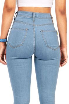 High waisted soft and stretchy skinny jeans in a vintage blue faded wash. Faux pockets at the front and open pockets at the back. Zip fly and button closure. *Machine Wash Cold *49% Siro Rayon 32% Cot