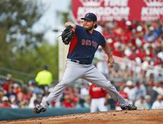 Boston Red Sox starting pitcher Wade Miley (20) works in the first inning of an exhibition spring training baseball game against the St. Louis Cardinals Monday, March 9, 2015, in Jupiter, Fla. (AP Photo/John Bazemore)