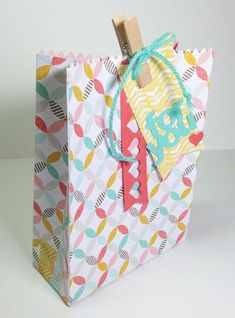 This stepped up treat bag uses the Mini Treat Bag Thinlits from Stampin Up with added side gussets to make the bag bigger.