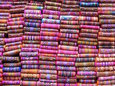 Pile of woven belts, Otavalo market Ecuador