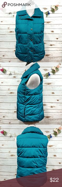"""Old Navy puffer vest This old navy puffer vest is a turquoise color. It zips and buttons up the front. 2 front pockets. Length from the top of the shoulder to the bottom is approx 23"""", just is approx 39"""". All measurements taken unstretched. Old Navy Jackets & Coats Vests"""
