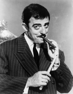Actor John Astin John Astin, who played the character Gomez Addams on the hit television show The Addams Family, uses a candle