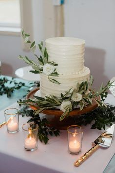 White wedding cake with greenery, florals