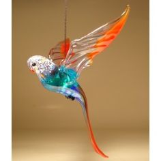 Glass Hanging Blue & Red Parrot Parakeet Ornament $25.95 http://www.glasslilies.com/92-glass-hanging-blue-red-parrot-parakeet-ornament.html #Glass #Red #Blue #Parrot #Parakeet #Bird #Ornament #Gifts #GlassArt #Figurine #BlownGlass