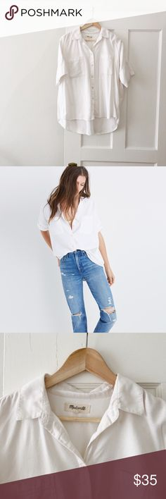 Madewell Courier Shirt White madewell button down courier shirt. Perfectly oversized, slightly boxy. Good used condition. See photos for piling and wear. A small spot at the hem (it may come out, I just haven't tried. Madewell Tops Button Down Shirts
